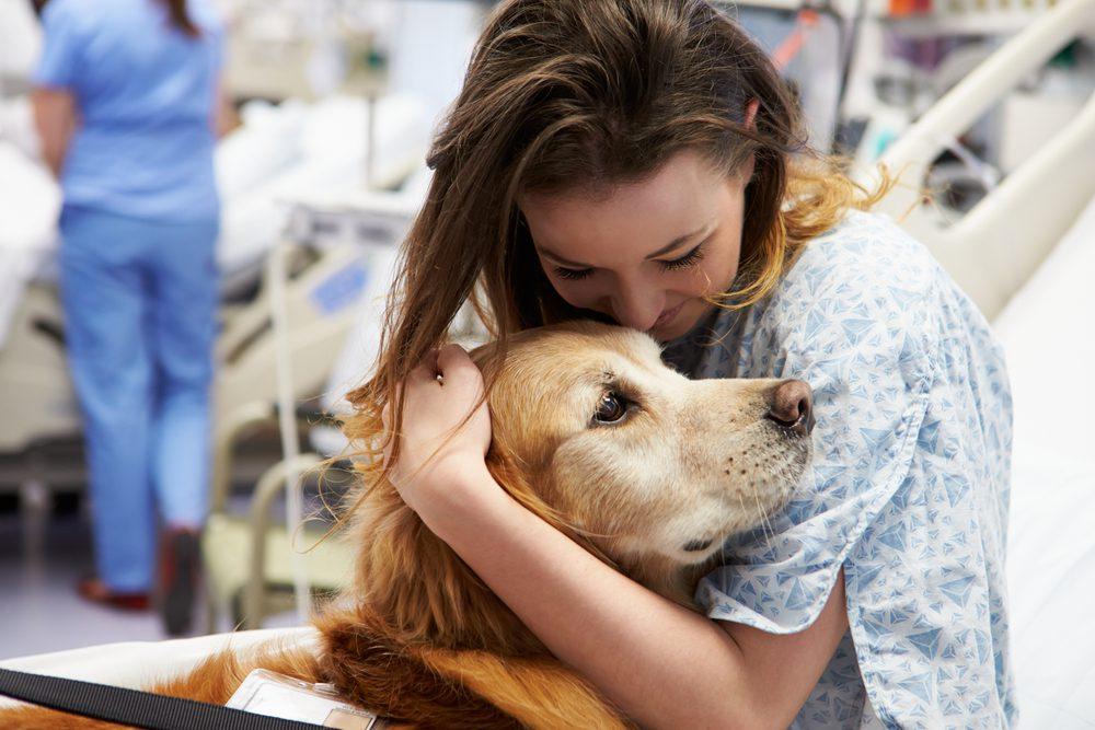 patient cuddling dog
